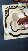 Robot Thymio en mode suiveur de ligne sur un tapis